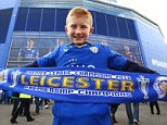 A young Leicester City fan with a 'Premier League Champions' scarf before the Barclays Premier League match between Leicester City and Southampton played at The King Power Stadium, Leicester on April 3rd 2016