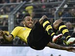 Dortmund's Pierre-Emerick Aubameyang celebrates his opening goal with a salto summersault during the German Bundesliga soccer match between Borussia Dortmund and Werder Bremen in Dortmund, Germany, Saturday, April 2, 2016. Dortmund defeated Bremen in a dramatic match with 3-2.  (AP Photo/Martin Meissner)