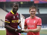 West Indiesí captain Darren Sammy, left, and England's captain Eoin Morgan pose with the winner's trophy a day ahead of their final match of the ICC World Twenty20 2016 cricket in Kolkata, India, Saturday, April 2, 2016.  (AP Photo/Bikas Das)