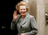 Britain's Prime Minister Margaret Thatcher waves to members of the media on returning to No. 10 Downing Street from Buckingham Palace after a visit with Queen Elizabeth II. Christie's is set to sell personal possessions of late British Prime Minister Margaret Thatcher, including papers, mementoes, clothes _ and her iconic handbags. The auctioneer said Tuesday, Nov. 3, 2015 that 150 lots will go under the hammer Dec. 15 in London, with another 200 sold by online auction.  The suit worn in this photo will be included in the auction.  (AP Photo/Dennis Redman, File)