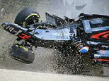 In this photo taken on March 20, 2016, McLaren Honda's Spanish driver Fernando Alonso crashes into the wall after colliding with Haas F1 Team's Brazilian driver Esteban Gutierrez during the Formula One Australian Grand Prix in Melbourne.   / AFP PHOTO / Newspix / Alex Coppel /  - Australia OUT / IMAGE RESTRICTED TO EDITORIAL USE - STRICTLY NO COMMERCIAL USE   ==  NO ARCHIVE ALEX COPPEL/AFP/Getty Images