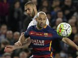 Barcelona's Javier Mascherano, front, shields the ball from Real Madrid's Karim Benzema, left during a Spanish La Liga soccer match between Barcelona and Real Madrid, dubbed 'el clasico', at the Camp Nou stadium in Barcelona, Spain, Saturday, April 2, 2016. (AP Photo/Emilio Morenatti)