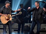 LAS VEGAS, NEVADA - APRIL 03:  Co-host Luke Bryan (L) and recording artist Blake Shelton perform onstage during the 51st Academy of Country Music Awards at MGM Grand Garden Arena on April 3, 2016 in Las Vegas, Nevada.  (Photo by Ethan Miller/Getty Images)