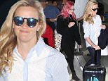 """*EXCLUSIVE* Los Angeles, CA - Reese Witherspoon and daughter Ava Phillippe catch a flight together out of LAX. Reese is wearing skinny jeans and a striped lace button up top paired with Puma sneakers. The 40-year-old actress is carrying a luggage with initials """"LWR"""" that represent her full name Laura Jeanne Reese Witherspoon. Ava is wearing all black in contrast to her bright pink hair. The two smile at cameras as they get ready to jet out. \n  \nAKM-GSI        April 3, 2016\nTo License These Photos, Please Contact :\nSteve Ginsburg\n(310) 505-8447\n(323) 423-9397\nsteve@akmgsi.com\nsales@akmgsi.com\nor\nMaria Buda\n(917) 242-1505\nmbuda@akmgsi.com\nginsburgspalyinc@gmail.com"""