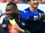 """Leicester City's Wes Morgan (left) celebrates scoring his side's first goal of the game with team-mates during the Barclays Premier League match at the King Power Stadium, Leicester. PRESS ASSOCIATION Photo. Picture date: Sunday April 3, 2016. See PA story SOCCER Leicester. Photo credit should read: Nick Potts/PA Wire. RESTRICTIONS: EDITORIAL USE ONLY No use with unauthorised audio, video, data, fixture lists, club/league logos or """"live"""" services. Online in-match use limited to 75 images, no video emulation. No use in betting, games or single club/league/player publications."""