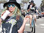 150169, EXCLUSIVE: Kesha enjoys a relaxed, carefree afternoon riding her bicycle in Los Angeles. Kesha enjoyed an afternoon cycling with a friend. Along the way the songstress stopped to cool down with a drink, and make a phone call and stroke a dog. Kesha, who is currently going through legal troubles with her record label, appeared in high spirits, stopping to flash a peace sign at photographers. Los Angeles, California - Saturday April 2, 2016.  Photograph: © PacificCoastNews. Los Angeles Office: +1 310.822.0419 UK Office: +44 (0) 20 7421 6000 sales@pacificcoastnews.com FEE MUST BE AGREED PRIOR TO USAGE