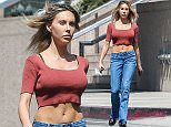 EXCLUSIVE. Coleman-Rayner. Los Angeles, CA, USA. March 31, 2016\nOlivia Newton-John's 30-year-old daughter Chloe Lattanzi struts down a Los Angeles street after leaving salon with a new haircut. Earlier in the day the pop singer/actress was seen make-up free, smoking a cigarette while walking her dog. \nCREDIT LINE MUST READ: RF/Coleman-Rayner.\nTel US (001) 310-474-4343- office\nTel US (001) 323-545-7584 - Mobile\nwww.coleman-rayner.com