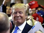 Republican presidential candidate Donald Trump reacts as he leaves a campaign stop Tuesday, March 29, 2016, in Janesville, Wis. (AP Photo/Nam Y. Huh)