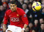 Manchester United's Cristiano Ronaldo (C) scores from a free kick during their English Premier League soccer match against Stoke City in Manchester, northern England, November 15, 2008. REUTERS/Phil Noble (BRITAIN).  NO ONLINE/INTERNET USAGE WITHOUT A LICENCE FROM THE FOOTBALL DATA CO LTD. FOR LICENCE ENQUIRIES PLEASE TELEPHONE ++44 (0) 207 864 9000.
