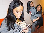 EXCLUSIVE: Rihanna was spotted hanging out with friends and fans at her Anti World Tour Concert in Philadelphia. She looked stunning , even after a long concert. She wore a grey tracksuit from her Fenty x Puma Collection. She posed for selfies, kissed friends on the cheek, signed copies of her Anti Album, and took some cheeky photos. She jokingly posed while others grabbed her breasts and rear end. Afterwards, everyone took a group photo, and she made cute funny faces. Rihanna even ended up taking down a few phone numbers, which she wrote on her own hand in sharpie marker.  Pictured: Rihanna Ref: SPL1256807  040416   EXCLUSIVE Picture by: 247PAPS.TV / Splash News  Splash News and Pictures Los Angeles: 310-821-2666 New York: 212-619-2666 London: 870-934-2666 photodesk@splashnews.com