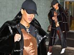Rihanna goes to the dentist in NYC wearing fuzzy coat, red leather pants and an oversized shirt\n\nPictured: Rihanna\nRef: SPL1256923  040416  \nPicture by: Jackson Lee / Splash News\n\nSplash News and Pictures\nLos Angeles: 310-821-2666\nNew York: 212-619-2666\nLondon: 870-934-2666\nphotodesk@splashnews.com\n