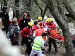 British woman is stretchered off after falling from cliffs