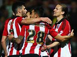 BRENTFORD, ENGLAND - APRIL 05:  Lasse Vibe (r) of Brentford celebrateswith team mates after scoring during the Sky Bet Championship match between Brentford and Bolton Wanderers at Griffin Park on April 5, 2016 in Brentford, United Kingdom.  (Photo by Bryn Lennon/Getty Images)