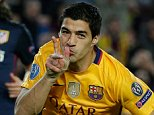 Barcelona's Luis Suarez celebrates after scoring his sideís second goal during a Champions League quarter-final, first leg soccer match between FC Barcelona and Atletico Madrid at the Camp Nou stadium in Barcelona, Spain, Tuesday April 5, 2016. (AP Photo/Emilio Morenatti)