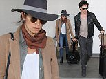 LOS ANGELES, CA - APRIL 05: Ian Somerhalder and Nikki Reed are seen at LAX on April 05, 2016 in Los Angeles, California.  (Photo by GVK/Bauer-Griffin/GC Images)