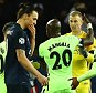 PARIS, FRANCE - APRIL 06:  Joe Hart (2nd R) of Manchester City is congratulated by his team mates on stopping a penalty by Zlatan Ibrahimovic (3rd L) of Paris Saint-Germain during the UEFA Champions League Quarter Final First Leg match between Paris Saint-Germain and Manchester City at Parc des Princes on April 6, 2016 in Paris, France.  (Photo by Clive Rose/Getty Images)