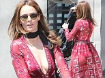 04 April 2016 - Los Angeles, CA - USA\n**STRICTLY AVAILABLE FOR UK AND GERMANY USE ONLY**\n*EXCLUSIVE ALL ROUND PICTURES* \nNicole Trunfio is seen on a stroll with her son Zion in LA. The Australian model is wearing a Barcelona Maxi Dress by Love and Lemons paired with a satin choker. Nicole shows off her cleavage in a plunging neckline as she loads Zion's stroller in her SUV.\nBYLINE MUST READ : AKM-GSI-XPOSURE\n***UK CLIENTS - PICTURES CONTAINING CHILDREN PLEASE PIXELATE FACE PRIOR TO PUBLICATION ***\n*UK CLIENTS MUST CALL PRIOR TO TV OR ONLINE USAGE PLEASE TELEPHONE 0208 344 2007*\n
