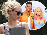 *EXCLUSIVE* Beverly Hills, CA - Iggy Azalea takes her cool Jeep for a spin while heading to the studio to work on new music. We also noticed her funny license plate cover saying: Sometimes I go Topless! Iggy wore a gray tank top with daisy dukes and strap blue sandals.\n  \nAKM-GSI      April 6, 2016\nTo License These Photos, Please Contact :\nSteve Ginsburg\n(310) 505-8447\n(323) 423-9397\nsteve@akmgsi.com\nsales@akmgsi.com\nor\nMaria Buda\n(917) 242-1505\nmbuda@akmgsi.com\nginsburgspalyinc@gmail.com
