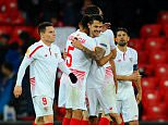 BILBAO, SPAIN - APRIL 07:  Sevilla players celebrate victory after the UEFA Europa League quarter final first leg match between Athletic Bilbao and Sevilla at San Mames Stadium on April 7, 2016 in Bilbao, Spain.  (Photo by David Ramos/Getty Images)