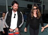 Los Angeles, CA - Christian Bale makes his way out of LAX scooting his son Joseph in his stroller and stopping to sign a few autographs for fans.  Christina's wife Sibi and daughter Emmeline held hands and followed Christian out to their car.\nAKM-GSI   April 5, 2016\n \n To License These Photos, Please Contact :\n \n Steve Ginsburg\n (310) 505-8447\n (323) 423-9397\n steve@akmgsi.com\n sales@akmgsi.com\n \n or\n \n Maria Buda\n (917) 242-1505\n mbuda@akmgsi.com\n ginsburgspalyinc@gmail.com