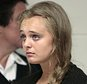 FILE - In this Aug. 24, 2015 file photo, Michelle Carter listens to defense attorney Joseph P. Cataldo argue for an involuntary manslaughter charge against her to be dismissed at Juvenile Court in New Bedford, Mass. Carter, of Plainville, Mass., is charged with involuntary manslaughter for allegedly pressuring Conrad Roy III, of Fairhaven, Mass., to commit suicide in 2014. Her lawyer will ask the Supreme Judicial Court Thursday, April 7, 2016, to overrule a lower court judge who refused to dismiss the youthful offender indictment against her, which makes her eligible for up to 20 years in prison instead of a lower sentence if she was prosecuted as a juvenile. (Peter Pereira/Standard Times via AP, Pool, File) MANDATORY CREDIT