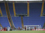 """A view of the empty seats at the Rome Olympic stadium during a Serie A soccer match between Lazio and Roma, Sunday, April 3, 2016. It was a curious atmosphere in the derby as fans from Roma and Lazio again boycotted the match in protest at the security measures that split the Stadio Olimpico """"curve"""", the ends of the stadium where the hardcore supporters sit. (Alessandro Di Meo/ANSA via AP)"""
