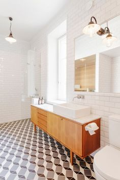 my scandinavian home -  Nice floor tiles and great combination with the mid century cabinet.