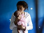 DENPASAR, BALI, INDONESIA - APRIL 21:  Heather Mack, 19, of the United States holds her baby daughter in a cell as she await her verdict hearing on April 21, 2015 in Denpasar, Bali, Indonesia. An Indonesian judge has sentenced Heather Mack to 10 years and her boyfriend Tommy Schaefer to 18 years in jail after they were found guilty of murdering Mack's mother, Sheila von Wiese-Mack, whose body was found stuffed inside a suitcase in the back of a taxi outside a luxury Bali hotel in August 2014. (Photo by Agung Parameswara/Getty Images)