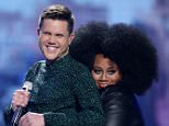 "Trent Harmon, left, and LaíPorsha Renae appear at the ""American Idol"" farewell season finale at the Dolby Theatre on Thursday, April 7, 2016, in Los Angeles. (Photo by Matt Sayles/Invision/AP)"