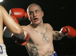 FILE- In this file photo from Nov. 22, 2006, Paul Spadafora boxes against Jesus Francisco Zepeda in a bout in Erie, Pa. Spadafora was charged Thursday, April 7, 2016 with simple assault and harassment for allegedly throwing a 63-year-old woman to the ground in the parking lot outside a Pittsburgh-area bar. (AP Photo/Keith Srakocic, FILE)