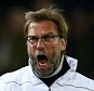 DORTMUND, GERMANY - APRIL 07:  Jurgen Klopp manager of Liverpool celebrates as Divock Origi of Liverpool scores their first goal during the UEFA Europa League quarter final first leg match between Borussia Dortmund and Liverpool at Signal Iduna Park on April 7, 2016 in Dortmund, Germany.  (Photo by Lars Baron/Bongarts/Getty Images)