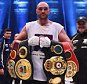 Tyson Fury celebrates with belts as he defeats Wladimir Klitschko to become new World Heavyweight Champion after the IBF IBO WBA WBO Heavyweight World Championship contest at Esprit-Arena on November 28, 2015 in Duesseldorf, Germany.    DUESSELDORF, GERMANY - NOVEMBER 28. (Photo by Lars Baron/Bongarts/Getty Images)