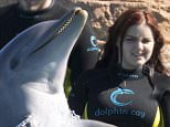 EXCLUSIVE: ** PREMIUM EXCLUSIVE RATES APPLY** Modern Family star Ariel Winter swims with dolphins on vacation at Atlantis Resort in the Bahamas.  Ref: SPL1258104  060416   EXCLUSIVE Picture by: Splash News  Splash News and Pictures Los Angeles: 310-821-2666 New York: 212-619-2666 London: 870-934-2666 photodesk@splashnews.com