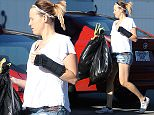 EXCLUSIVE: The pregnant ex-nanny of Gavin Rossdale and Gwen Stefani, Mindy Mann throws garbage bags into her car and then drives off.   Pictured: Mindy Mann Ref: SPL1258736  060416   EXCLUSIVE Picture by: Bello / Splash News  Splash News and Pictures Los Angeles: 310-821-2666 New York: 212-619-2666 London: 870-934-2666 photodesk@splashnews.com