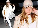 New York, NY - Gigi Hadid returns to her NYC apartment. The 20-year-old model is wearing an all white monochrome look. Gigi is on board with the baseball cap trend matching it with her outfit. \n  \nAKM-GSI        April 6, 2016\nTo License These Photos, Please Contact :\nSteve Ginsburg\n(310) 505-8447\n(323) 423-9397\nsteve@akmgsi.com\nsales@akmgsi.com\nor\nMaria Buda\n(917) 242-1505\nmbuda@akmgsi.com\nginsburgspalyinc@gmail.com