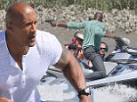 Exclusive... 52014941 Actor Dwayne 'The Rock' Johnson films an intense action scene in the ocean for the upcoming movie 'Baywatch' on April 6, 2016 in Savannah, Georgia. During the scene Dwayne chased bad guys on his boat while they shot at him. FameFlynet, Inc - Beverly Hills, CA, USA - +1 (310) 505-9876