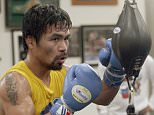In this Monday, April 4, 2016, photo, boxer Manny Pacquiao, of the Philippines works out in front of reporters and photographers at the Wild Card gym in Los Angeles. Pacquiao is scheduled to fight Timothy Bradley in Las Vegas on Saturday, April 9. (AP Photo/Nick Ut)