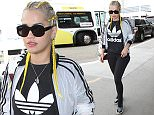 LOS ANGELES, CA - APRIL 07: Rita Ora is seen at LAX on April 07, 2016 in Los Angeles, California.  (Photo by GVK/Bauer-Griffin/GC Images)