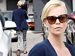 06.April.2016 - Beverly Hills, CA ñ USA\n***EXCLUSIVE ALLROUND PICTURES***\n*** STRICTLY AVAILABLE FOR UK AND GERMANY USE ONLY ***\nCharlize Theron tries to hide her face as she continues her hump day errands. She's seen leaving Meche Salon. \nBYLINE MUST READ : AKM-GSI-XPOSURE\n***UK CLIENTS - PICTURES CONTAINING CHILDREN PLEASE PIXELATE FACE PRIOR TO PUBLICATION ***\n*UK CLIENTS MUST CALL PRIOR TO TV OR ONLINE USAGE PLEASE TELEPHONE 0208 344 2007*
