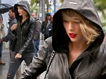 Beverly Hills, CA - Taylor Swift looks lovely in black leather for some rainy weather shopping in Beverly Hills. Taylor carried her black leather Saint Laurent handbag with her hood up, in a pair of distressed skinnies and black leather booties as she stopped at a upscale clothing store with her bodyguard.\nAKM-GSI    April 7, 2016\nTo License These Photos, Please Contact :\nSteve Ginsburg\n(310) 505-8447\n(323) 423-9397\nsteve@akmgsi.com\nsales@akmgsi.com\nor\nMaria Buda\n(917) 242-1505\nmbuda@akmgsi.com\nginsburgspalyinc@gmail.com