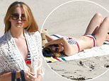06 April 2016 - Malibu, CA - USA **STRICTLY AVAILABLE FOR UK AND GERMANY USE ONLY** *EXCLUSIVE ALL ROUND PICTURES*  Singer Lana Del Rey, 30, stripped off while soaking up the sun on a Malibu beach wearing a two-piece striped bikini. BYLINE MUST READ : AKM-GSI-XPOSURE ***UK CLIENTS - PICTURES CONTAINING CHILDREN PLEASE PIXELATE FACE PRIOR TO PUBLICATION *** *UK CLIENTS MUST CALL PRIOR TO TV OR ONLINE USAGE PLEASE TELEPHONE 0208 344 2007*