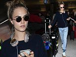 Los Angeles, CA - Cara Delevingne looks casual and cute as she arrives at LAX in a sweater with loose distressed jeans paired with funky socks and white sneakers. \n  \nAKM-GSI      April 8, 2016\nTo License These Photos, Please Contact :\nSteve Ginsburg\n(310) 505-8447\n(323) 423-9397\nsteve@akmgsi.com\nsales@akmgsi.com\nor\nMaria Buda\n(917) 242-1505\nmbuda@akmgsi.com\nginsburgspalyinc@gmail.com