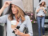 EXCLUSIVE TO INF. \nApril 8, 2016: Cindy Crawford puts her hoodie to good use as she makes her way through the morning rain with coffee in hand, Malibu, CA.\nMandatory Credit: Borisio/SAA/INFphoto.com Ref.: infusla-277/302