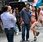 A young woman poses with tourists in Times Square wearing body paint to cover herself August 19, 2015 in New York. Mayor Bill de Blasio said that he sees the desnudas in Times Square as pushy panhandlers whose efforts to separate tourists from their money should be regulated.   AFP PHOTO/DON EMMERT        (Photo credit should read DON EMMERT/AFP/Getty Images)