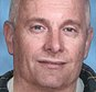 This age enhanced photo provided by the FBI shows what Arizona fugitive Robert William Fisher would look like today. Fisher, would be 54 now, has been missing since his Scottsdale home exploded in April 2001 and his wife and two children were found dead inside. Fisher is the prime suspect. (Courtesy of the FBI via AP)