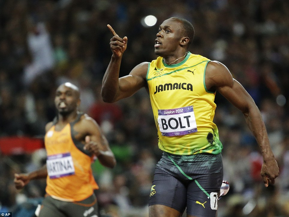 Making his point: Bolt celebrates after crossing the finishing line in first in the 100m final at the London Olympic Games
