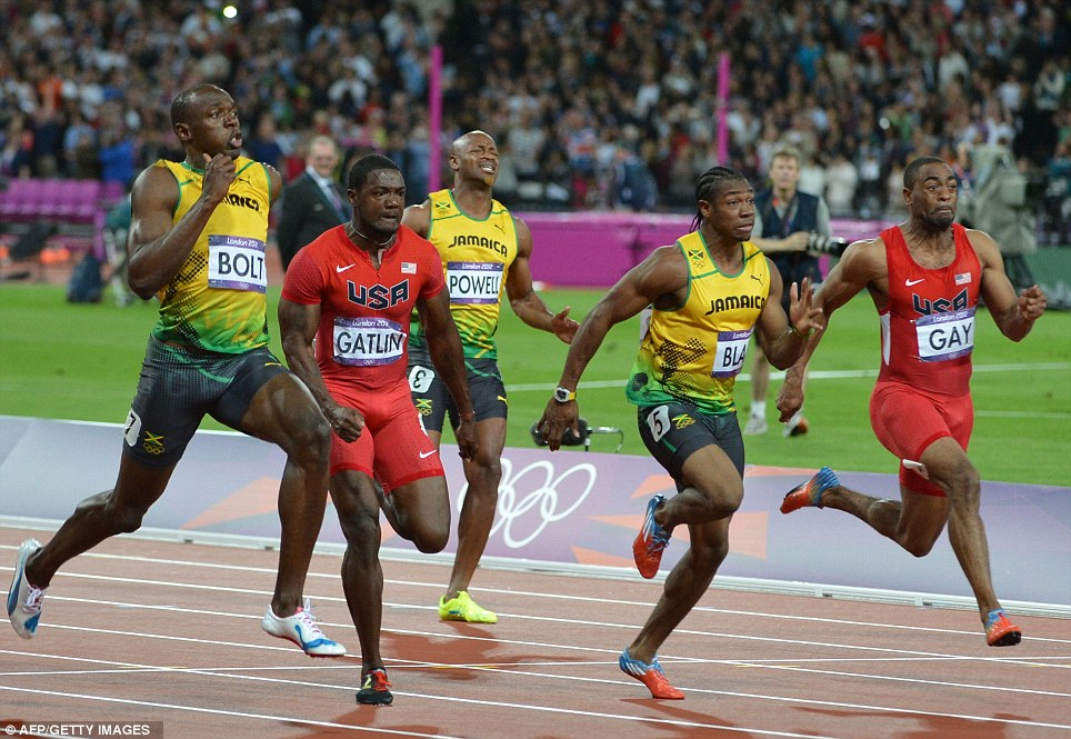 Close call: Bolt did not run away with the race as he had done four years ago in Beijing, with Blake, Gatlin and Gay all running super quick times