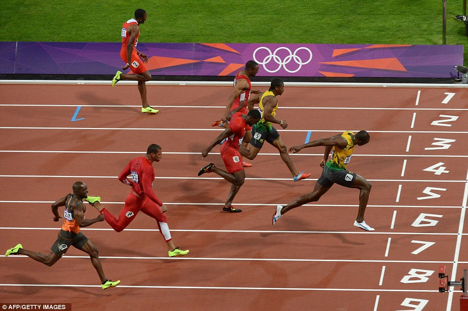 Dip for the line: Bolt finishes ahead of Yohan Blake (second right) and Justin Gatlin (third right) to win the Olympic gold medal