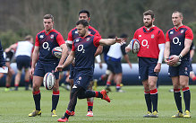 Danny Care kicks the ball during an England training session at Pennyhill Park