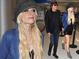 Richie Sambora & Orianthi are all smiles as they catch a flight out of Los Angeles.  The musically inclined couple are seen flying out of LAX.  Pictured: Richie Sambora, Orianthi Ref: SPL1259851  080416   Picture by: Sharky/Polite Paparazzi/Splash  Splash News and Pictures Los Angeles: 310-821-2666 New York: 212-619-2666 London: 870-934-2666 photodesk@splashnews.com